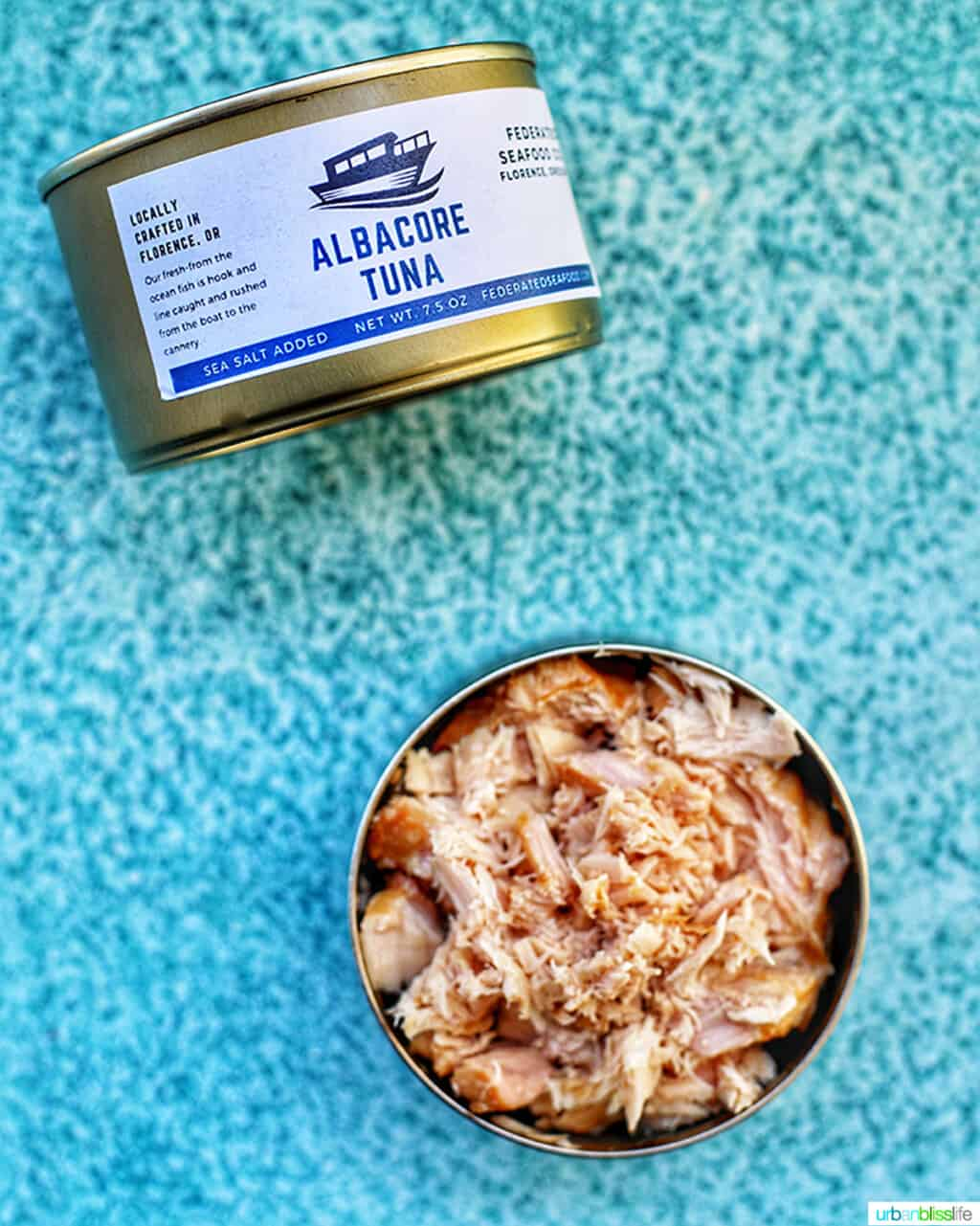 canned albacore tuna on blue background