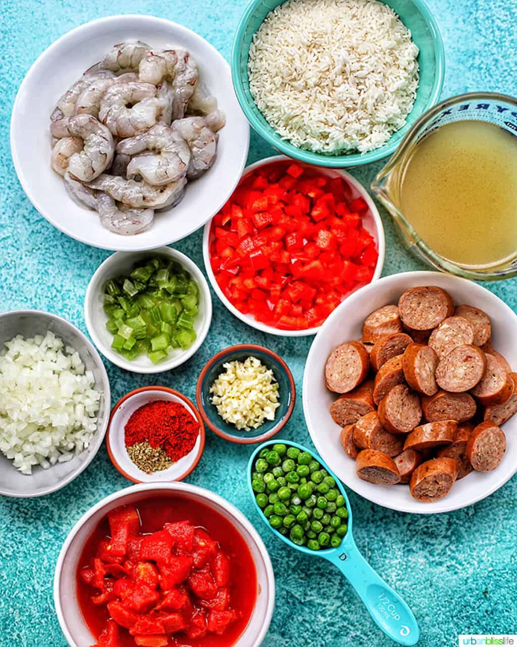 bowls of ingredients for seafood jambalaya