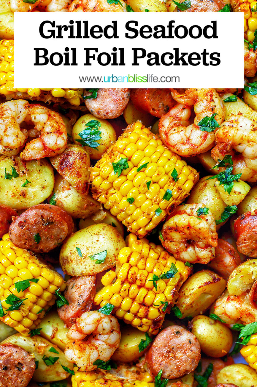 tray of seafood, corn, sausage low country boil with text overlay