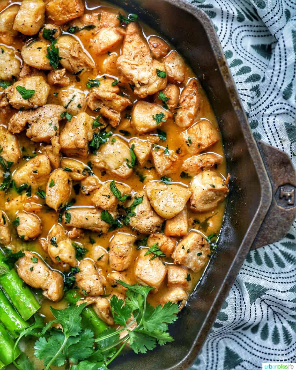 soy garlic butter chicken bites in cast iron pan
