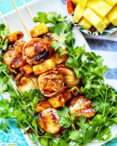 grilled bacon-wrapped scallop skewers with pineapple and parsley