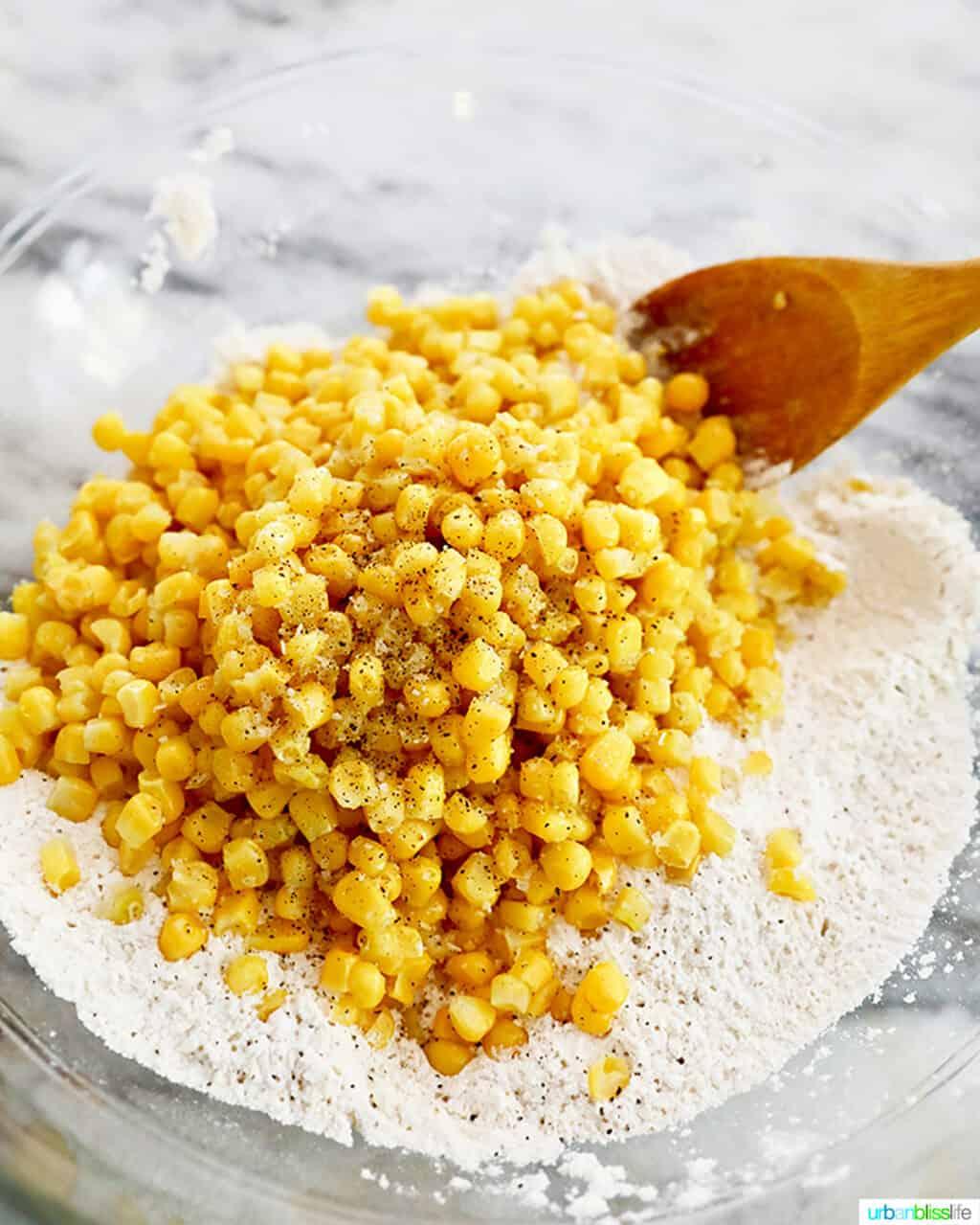 mixing corn into corn fritter batter