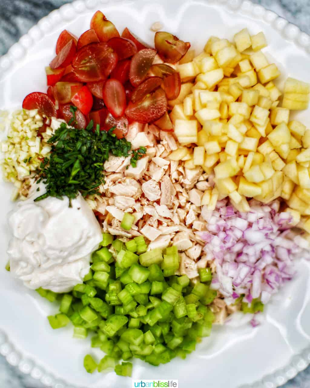 bowl of ingredients for chicken salad sandwiches