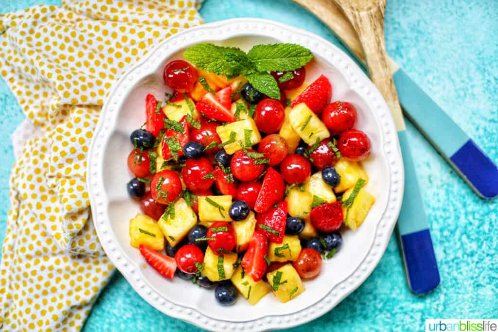 landscape photo of simple fruit salad with salad tongs