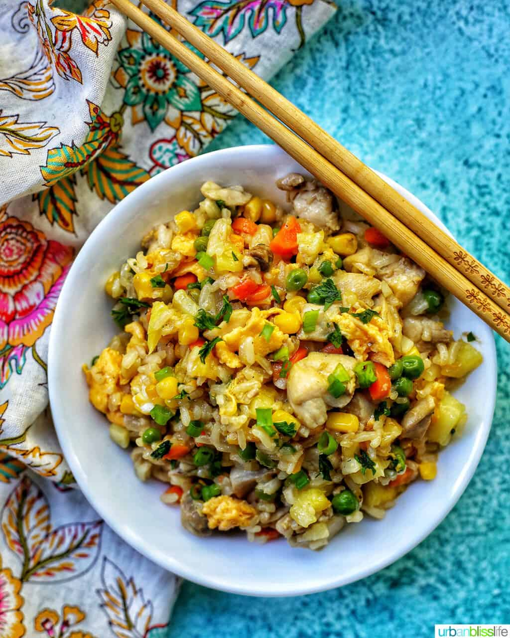 bowl of pineapple fried rice with chopsticks