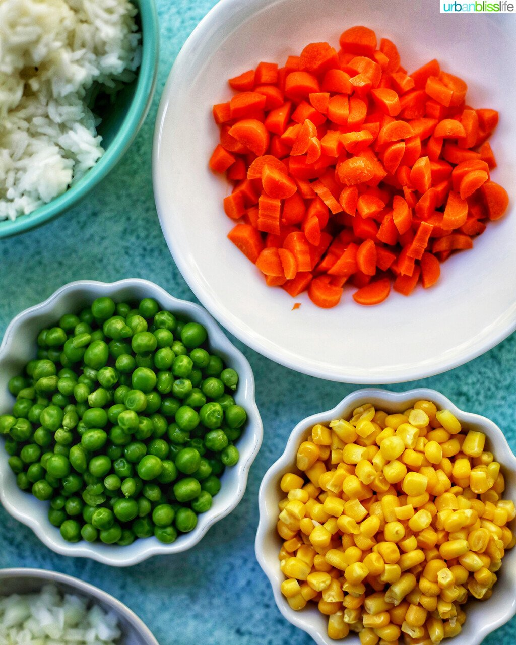 bowls of carrots peas and corn