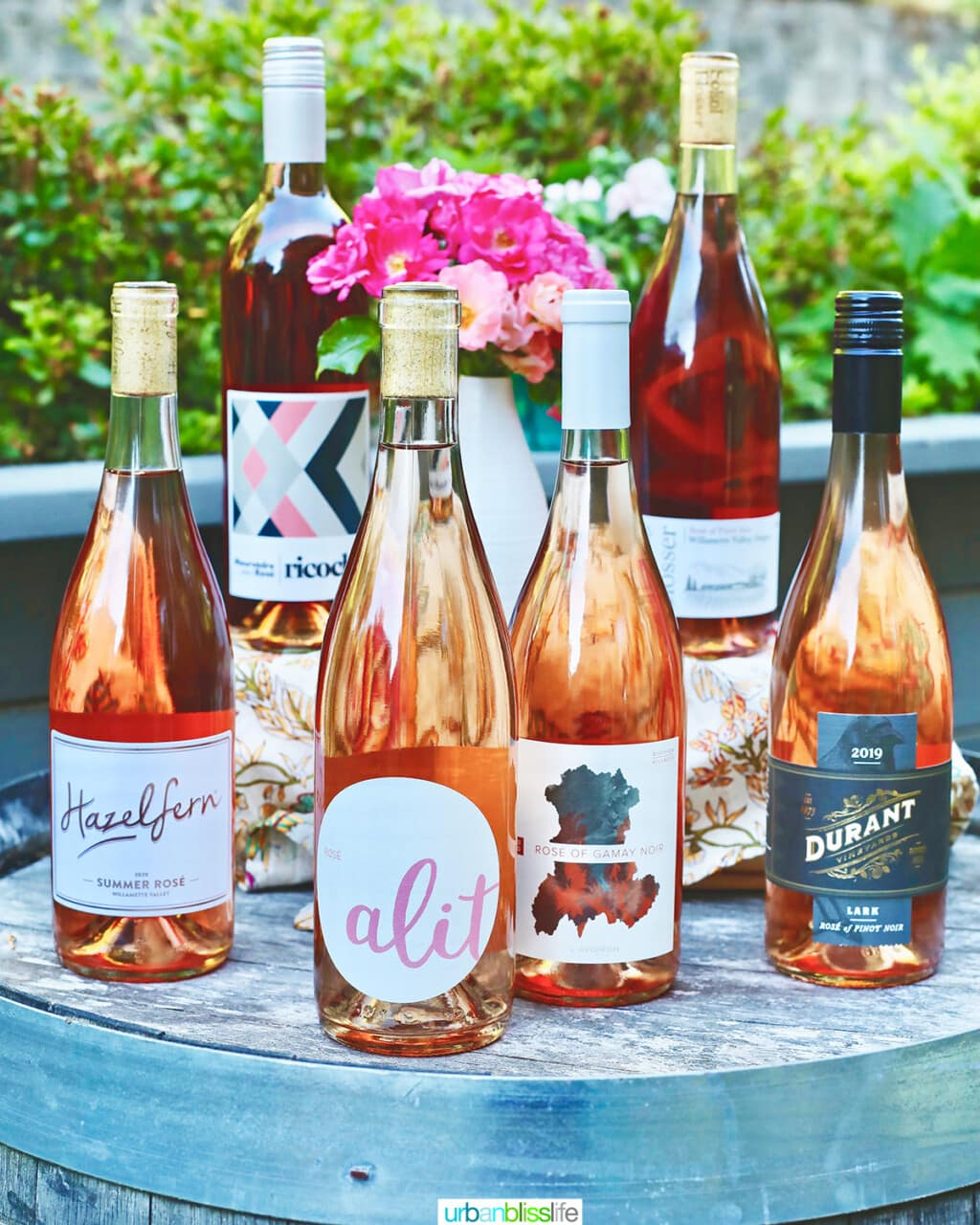 7 bottles of the best rosé wines to drink in 2021 on a wine barrel