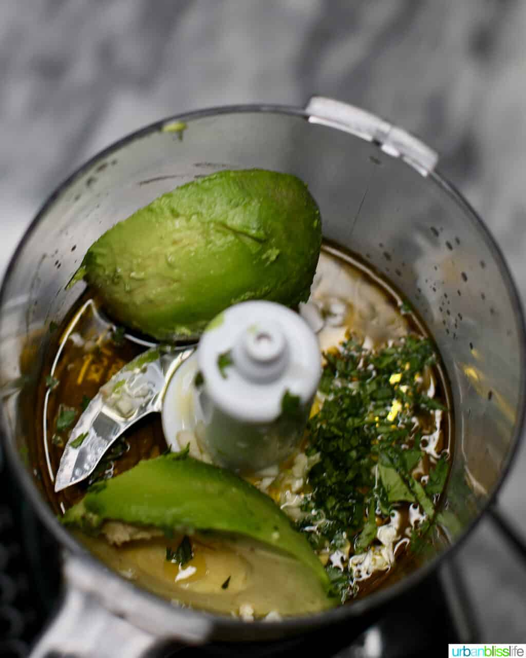 avocados and ingredients for pasta salad sauce in a food processor