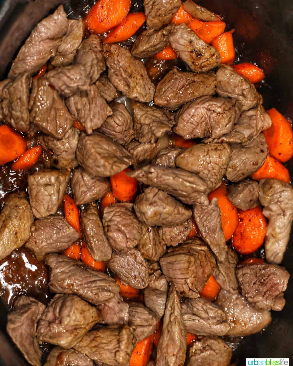 stew meat and carrots in dutch oven
