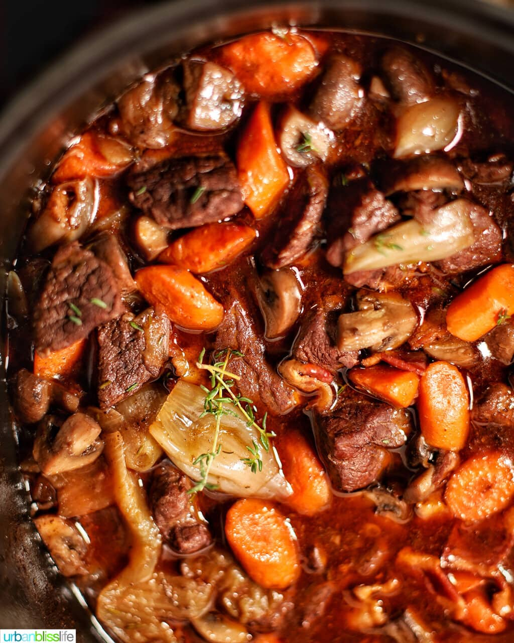 beef bourguignon cooking with bay leaf