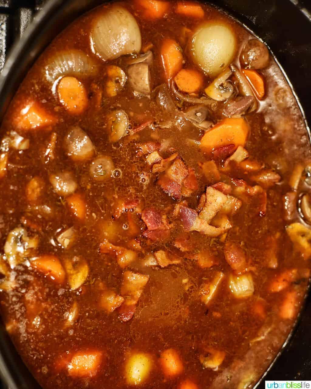 beef bourguignon cooking in pot