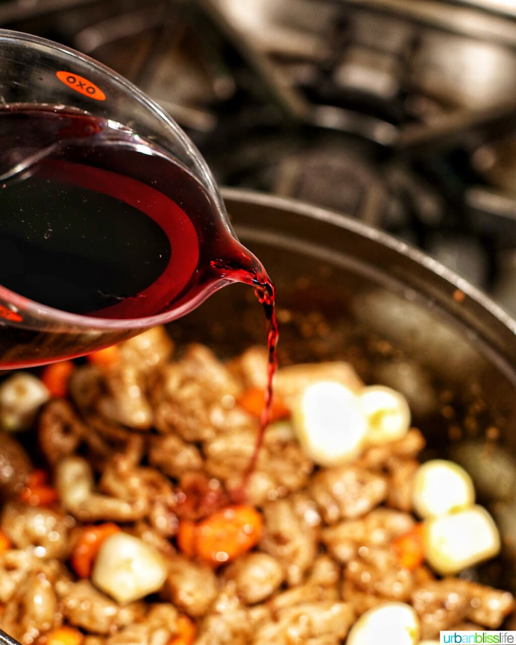 adding red wine to beef bourguignon