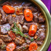 close up of beef bourguignon in big bowl