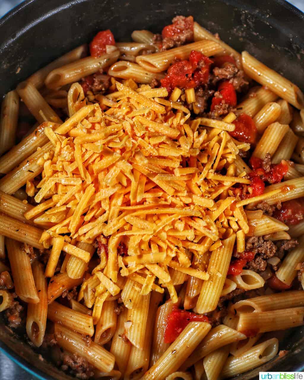 adding dairy-free cheddar shreds to pasta