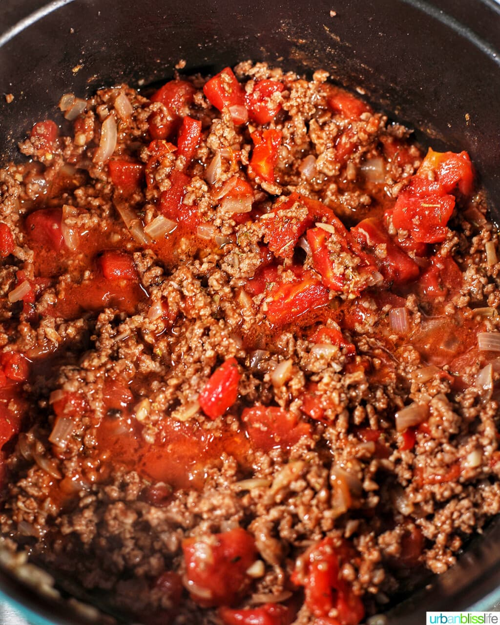 adding tomatoes to ground beef