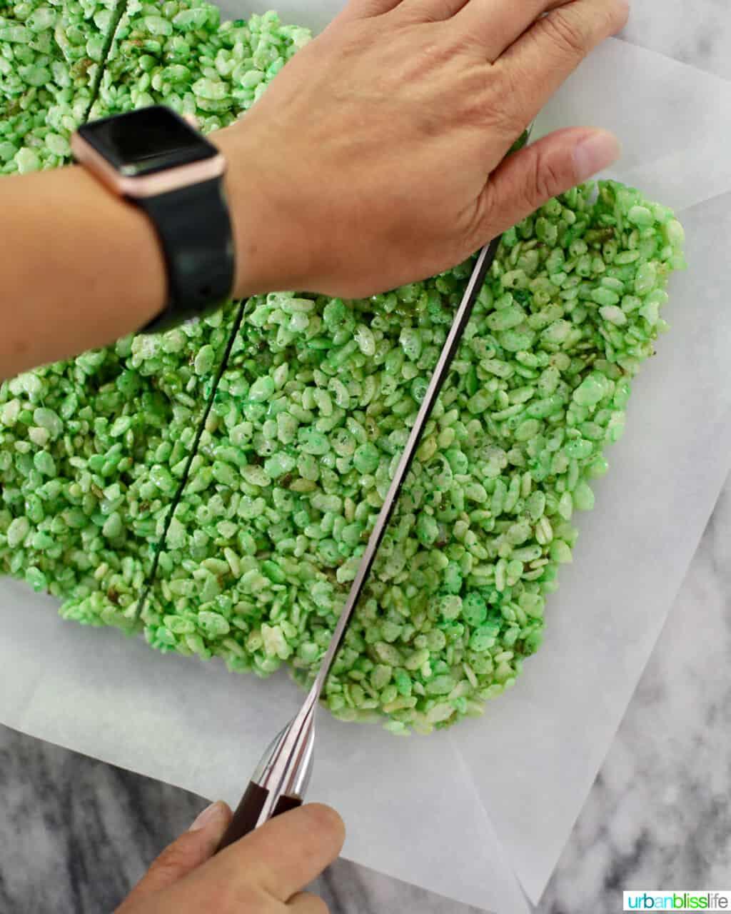 slicing into Frankenstein Rice Krispie Treats