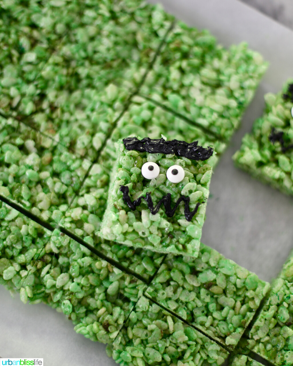 one decorated Frankenstein Rice Krispie on top of the batch of treats