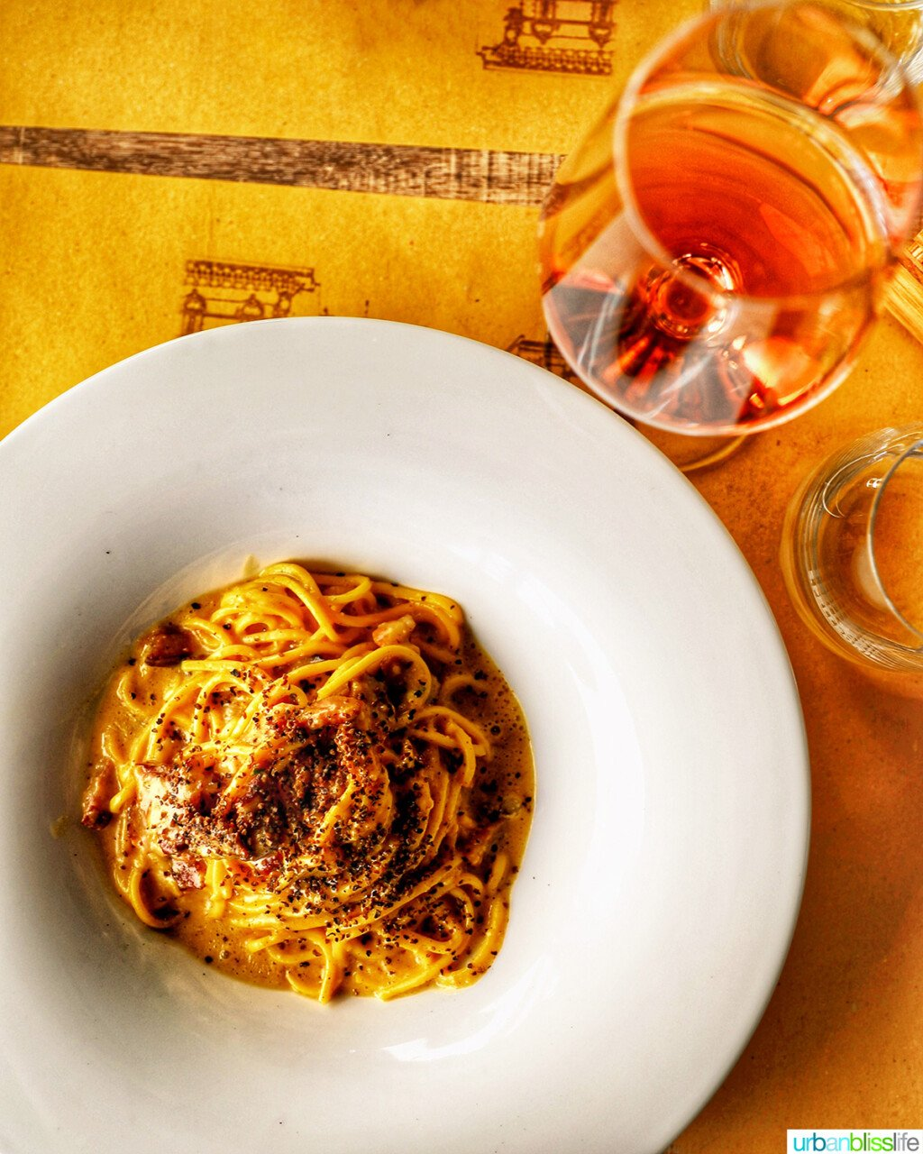 spaghetti carbonara with rosé wine