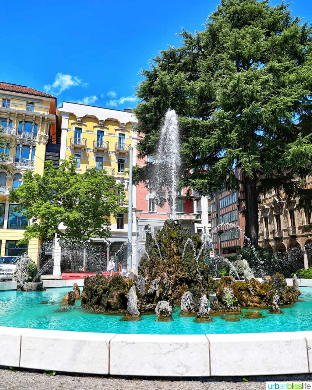 fountain against colorful buildings in Lugano, Switzerland