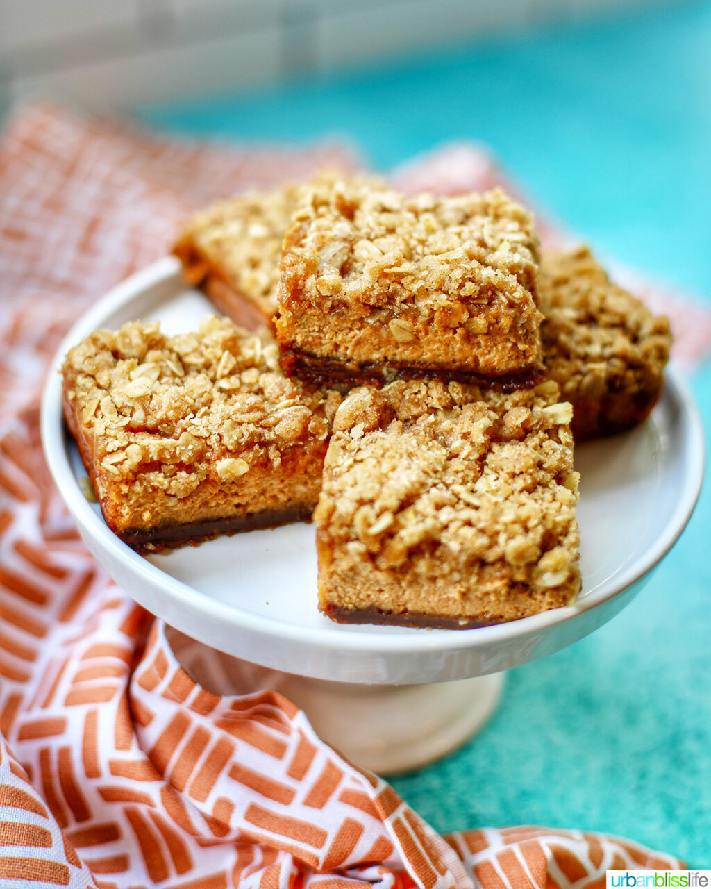 Pumpkin Cheesecake Bars with Gingersnap Crust on plate