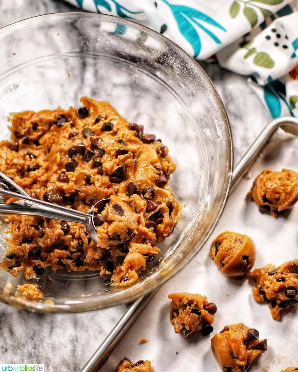 scooping cookie batter onto baking sheet