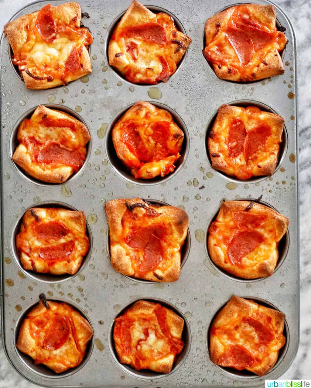 baked pizza cups in muffin tin